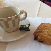 Petite pain au chocolate with an espresso and a cute, wrapped sugar cube.