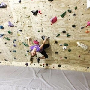 girl stretching on wall